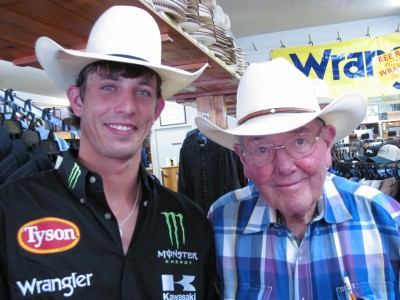 Champion bull rider JB Mauney with Jedlicka's owner, Si Jenkins